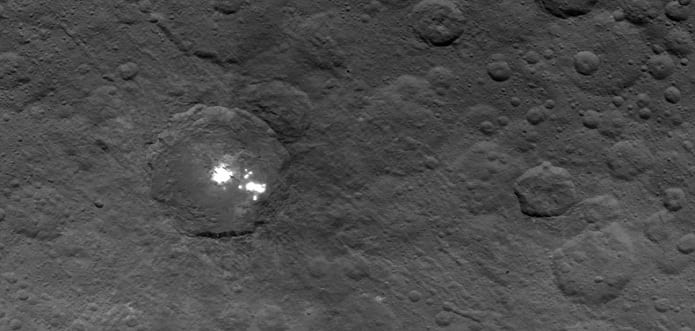 NASA's Dawn takes close-ups of Ceres's strange white spots, no explanation yet