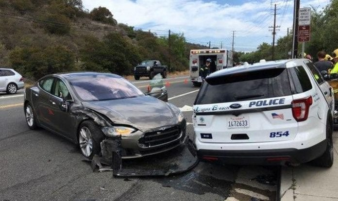 Tesla car in 'autopilot mode' crashes into parked police vehicle
